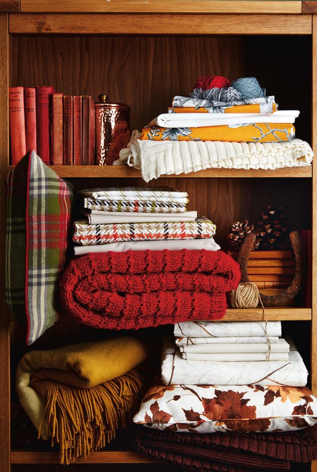 Stay cosy during the winter months with woollen throws and super-soft cushions