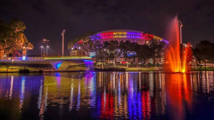 Adelaide's river precinct, lit up with Crows colours in honour of murdered coach, Phil Walsh