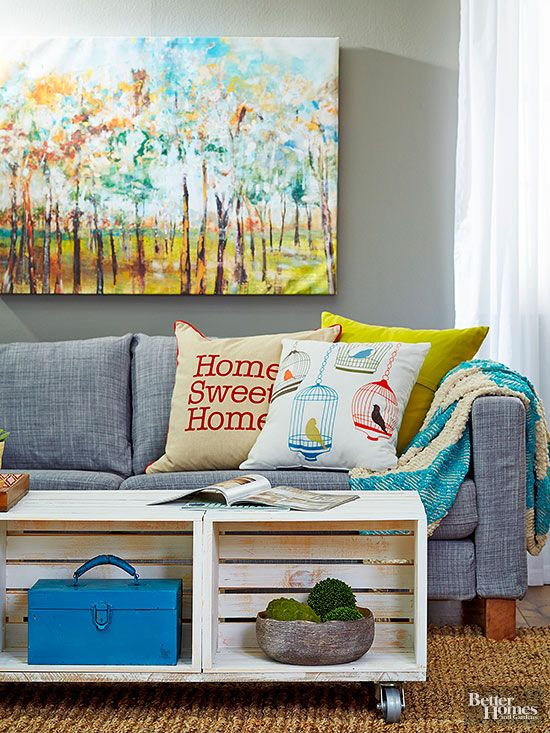 Turn six brand new wood crates into a simple, yet, sturdy coffee table in no time. Give the entire display a distressed finish by lightly dipping a paintbrush into semigloss paint, brushing off excess, and brushing over the entire piece; let dry.