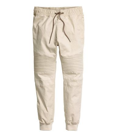 12f32e9851fdc0 Jogger-style pants in washed cotton twill. Elasticized drawstring  waistband, mock fly, side pockets, and welt back pockets. Tapered …   H&M  MAN DIVIDED ...