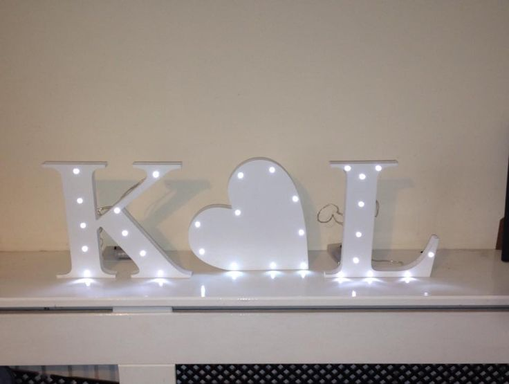 Beautiful painted wooden letters with a heart in between. 10 fairy lights added to each piece. They each measure 20cm high so pretty big.You can have each piece painted in any colour of your choice. Please just add a note to your order with your colour and letter choices.I have added a photo to show the back where the wires are stapled and the battery pack is. Each piece will require 2aa batteries. Royal Mail prohibits posting batteries so I'm afraid batteries are not included.Any question…