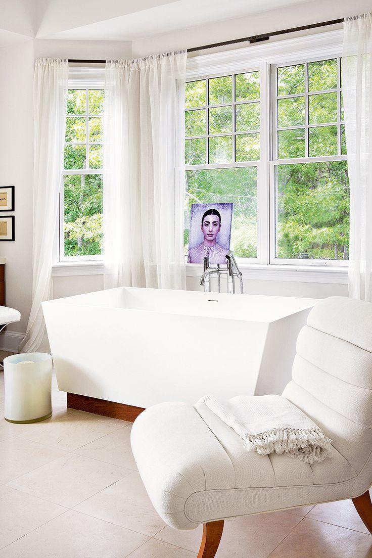 Tour a Gorgeously Layered, Artistic Hamptons Home// modern bathtub, square bathtub