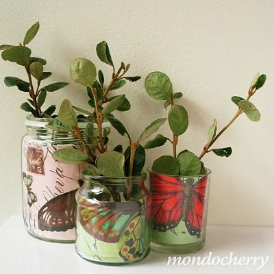 here is a cheap and easy way to recycle postcards or greeting cards, and those old jam jars or glasses you might have hidden away at the back of a cupboard. Joy just placed smaller glass jars inside larger ones (to hold the water) and slipped these pretty butterfly postcards in between. If, like her, you haven't treated yourself to any flowers this week, a few leafy twigs are just as effective.
