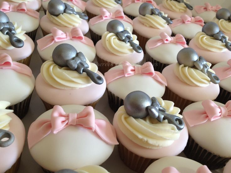 Rattles & Bows Cupcakes - All edible cupcake toppers. the rattles are sprayed with edible silver lustre dust and the bows are each individually made by hand