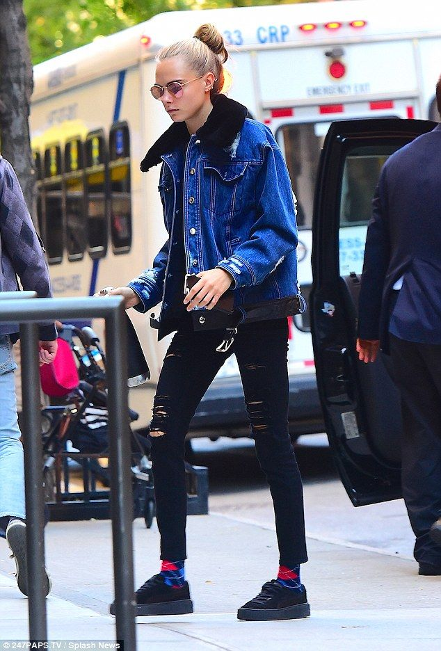 Hipster: Cara Delevigne looked off-beat cool when she stepped out in Los Angeles on Wednesday, where she paid a visit to Mount Sinai Hospital