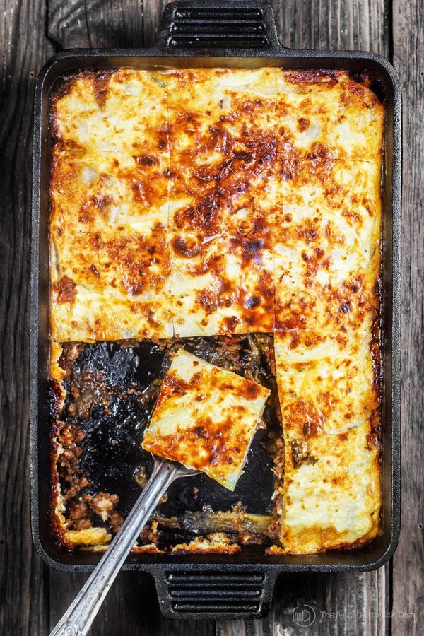 Moussaka Recipe | The Mediterranean Dish. A layered eggplant casserole with potatoes and a hearty spiced meat sauce nestled in between.  All topped with a thin cheese-based topping. Step-by-step photos will guide you through cooking this Greek comfort food!