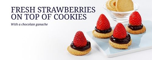 Fresh strawberries on top of cookies