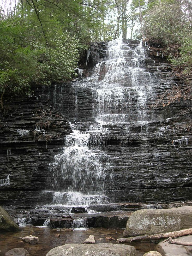 Benton Falls in the Cherokee National Forest, in the Southern Appalachian Mountains of east Tennessee;  65 feet high... I've stood on the top of this