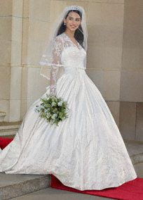 Inspired by the one worn by Kate Middleton!  V-neck bodice features elegant lace sleeves for a sophisticated and demure look.  Full ball gown skirt adds volume and drama.  Fully lined. Back zip. Dry clean only.  Available in Ivory online and in limited stores. To preserve your wedding dreams, try our Wedding Gown Preservation Kit.