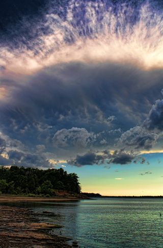 A crown of clouds tops the Lake Eufaula, Oklahoma shoreline in magnificent fashion.