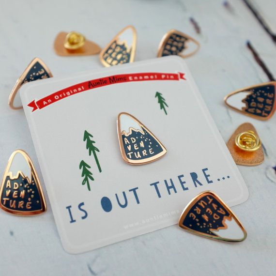 This little enamel pin badge is mountain shaped with the wording adventure. A…