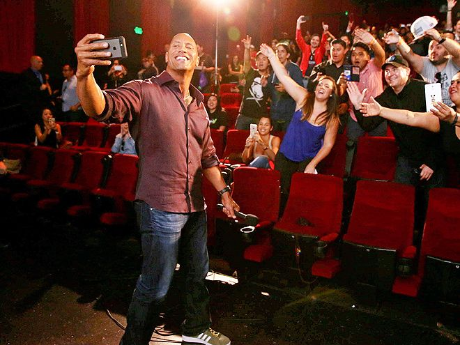 "Star Tracks: Wednesday, May 20, 2015 | FAN-DEMONIUM | San Andreas star Dwayne ""The Rock"" Johnson makes a snap decision with fans at a Tuesday screening of the film in Hollywood."