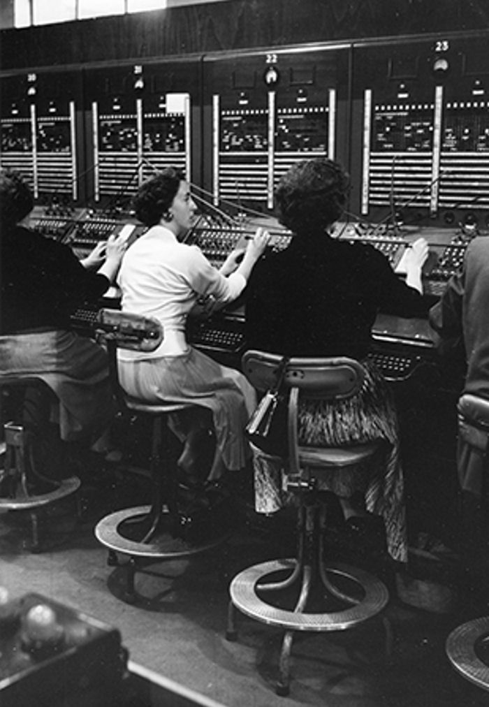 Operators, Central Telegraph Office, London, 1957. Photographer Edwin Smith.  In the 1930s his photographs of the city demonstrate a social documentary approach, which is echoed in his later photographs of London in the 1950s and 1960s.