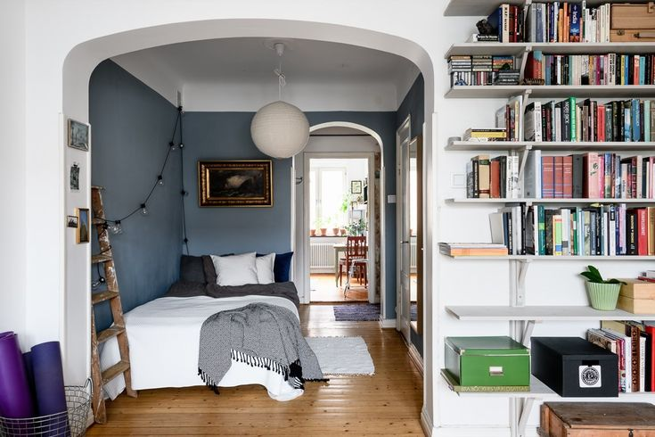 Studio apartment with blue bed nook