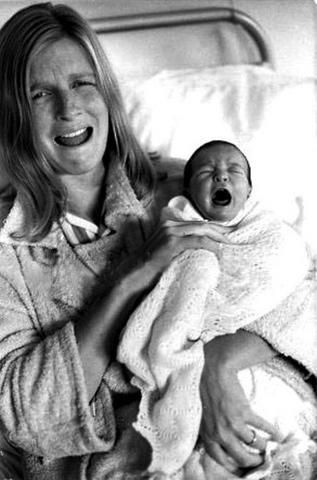 Linda Eastman-McCartney with one of her children. The look on her face is priceless!