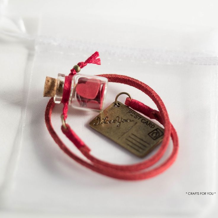 Mini-bottle with red paper hearts & postcard-Status: available.