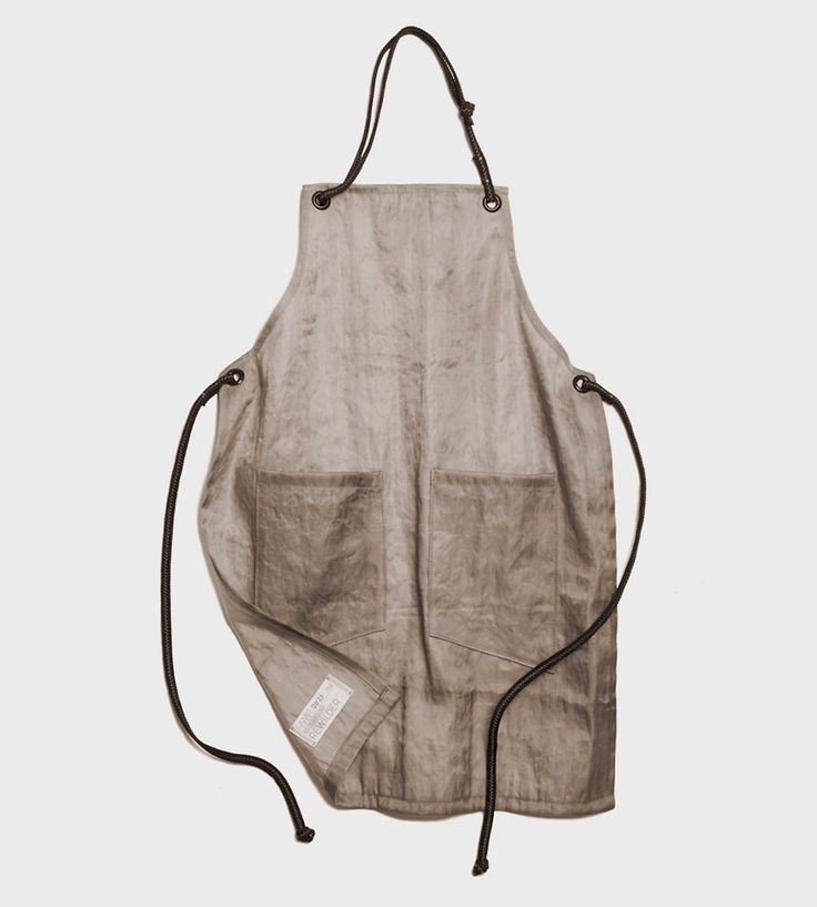 Tie on this industrial apron whenever you need to dig in and get your hands dirty. The apron is sewn from heavy-duty beer filter cloth and climbing rope, for a familiar shape in repurposed materials. Lightweight, strong and durable, it's made for brewers, bartenders, barbecuers and artists alike.