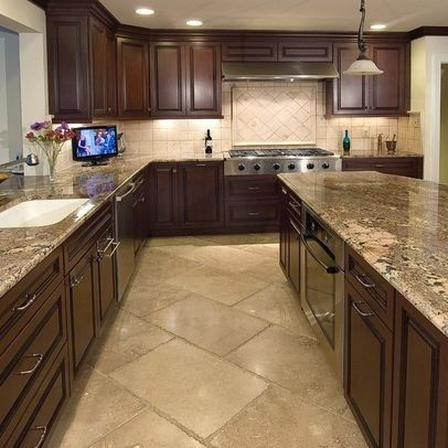 tile floor, light countertop, dark cabinets