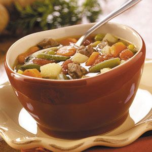 Slow-Cooker Vegetable Soup Recipe -What a treat to come home from work and have this savory soup ready to eat. It's a nice traditional beef soup with old-fashioned goodness. We pair it with crusty rolls topped with melted mozzarella cheese.                                   — Heather Thurmeier, Pense, Saskatchewan