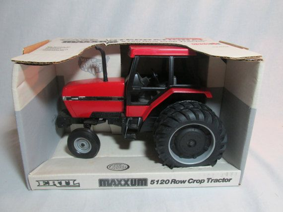 The Maxxum 5120 Ro Crop Tractor is 1/16 sscale model of Case International tractor. It is Special Edition, new in original box, diecast metal toy stock#634 by Ertl Toys and made in the USA. It is recommended for 3+ years. It also has Steerable Front End , deep ribbed tires,and rear hitch. The backside corner of the box is little crimped. BTg3725DBk