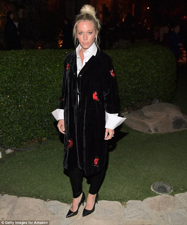 Covering up: Kendra Wilkinson looked demure at a party to launch the Amazon Original Series American Playboy: The Hugh Hefner Story at the Playboy Mansion in Los Angeles on Tuesday