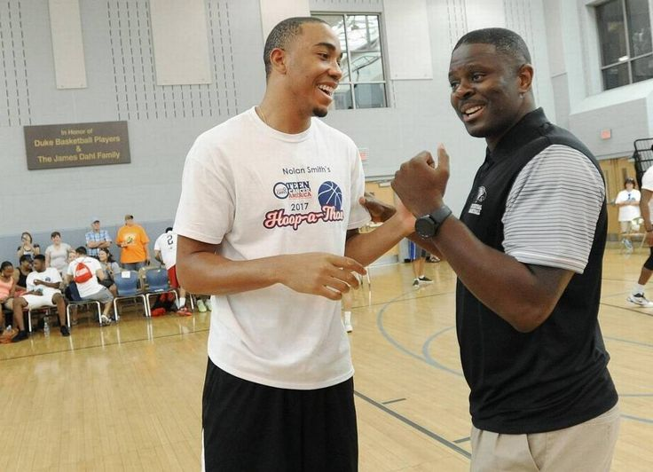 Brice Johnson, LeVelle Moton joke around at Nolan Smith's hoop-a-thon to raise money for cancer.