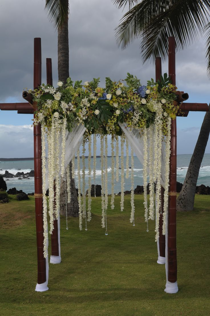 Gorgeous arche with flowers. Destination wedding in Maui, Hawaii. Flowers by Teresa Sena Designs.  Photo by www.TadCraigPhotography.com