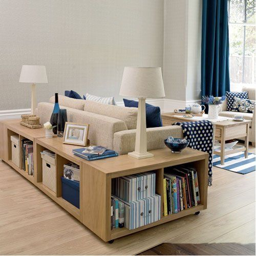 """Wrap"" couch with bookshelves for extra storage"