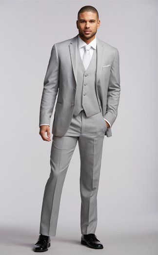 This ensemble includes Joseph Abboud two-button light gray super 120s framed notch lapel, grey flat front pant, white microfiber point collar shirt, Joseph Abboud light grey vest, primetime silver euro, white pocket silk, white/silver stud and cufflink set, black socks, and Joseph Abboud patent leather shoes.