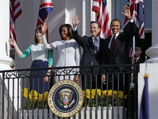 England's Prime Minister David Cameron and his wife Samantha wave from the White House Balcony, with President and Mrs. Obama, on March 14, 2012.
