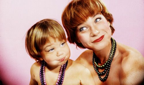 Shirley Maclaine and her two 1/2 year old daughter Sachi Parker as they make faces during a photo shoot, January 1959. Photo Allan Grant
