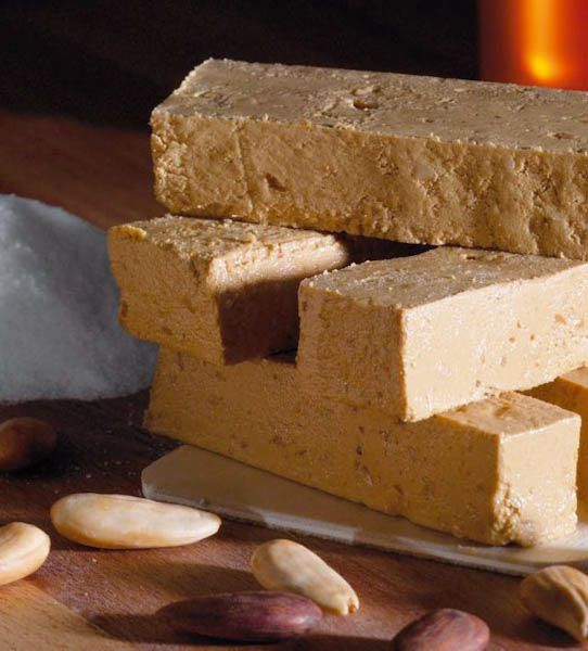 Torró is confectionary, normally made of honey, sugar and egg white, with toasted almonds or other nuts and usually shaped into a rectangular tablet. These sweets are especially eaten during Christmas in Catalonia, however, they are available all year round.
