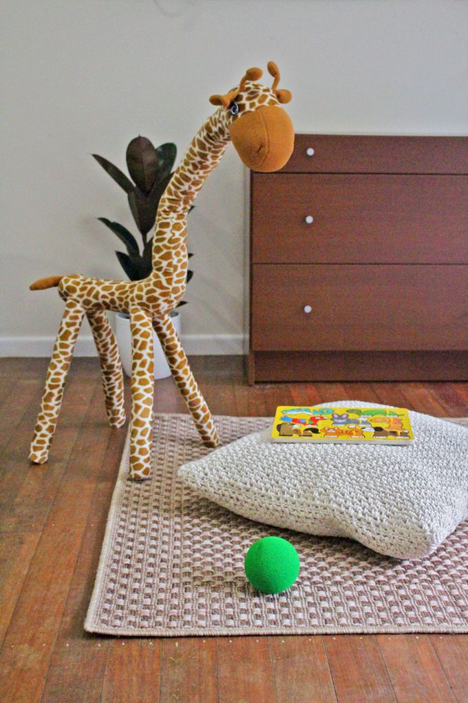 Use an outdoor rug in your kids room - easy to clean! Gerald the giraffe hanging out on our Landen outdoor rug.