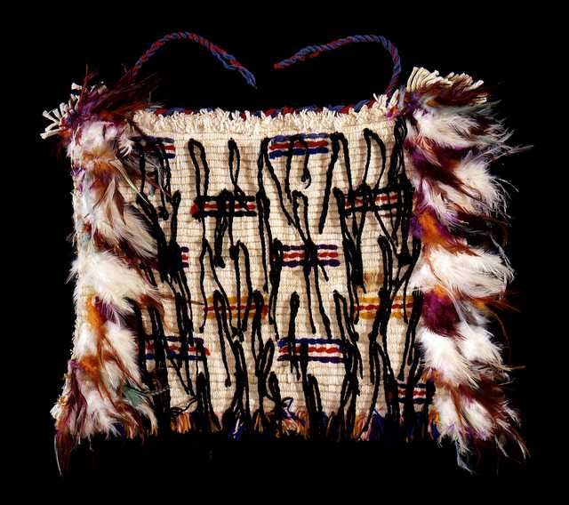 Korowai, candlewick, wool, feather, muka. Te Papa collection