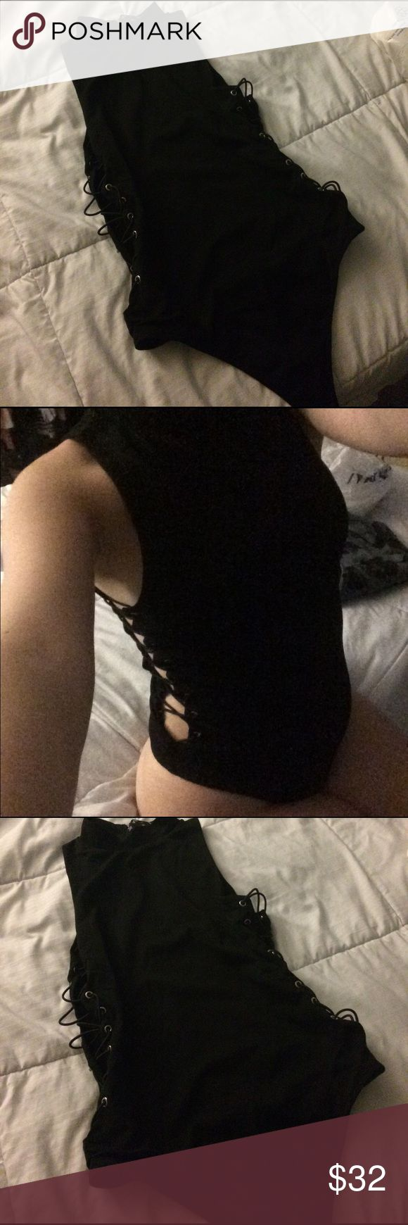 Nasty Gal Body Suit NWT Nast Gal Body Suit in jet black. Never worn, just for the photo. Elastic sides and thong back. Runs a little small. Made in USA. Tag says M but fits Small more like 2-4 Nasty Gal Tops