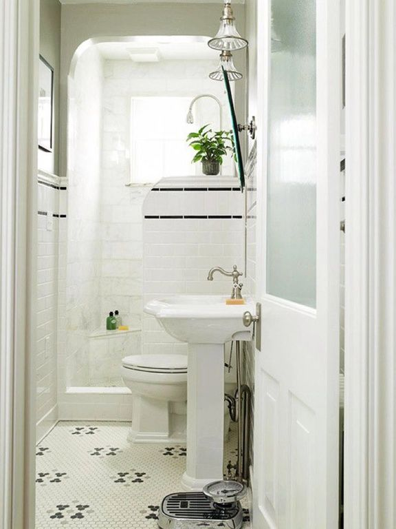 Traditional 3/4 Bathroom With Glass Panel Door, Pedestal Sink, Penny Tile  Floors