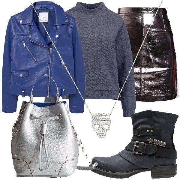 Per una donna sempre rock, che non può rinunciare ad esserlo neppure durante le feste, ecco un abbinamento rock luminoso. Cominciamo dalla gonna in pelle, color argento, la borsa a secchiello argentata, con borchie e la collana con pendente, a forma di teschio, costellato da strass. Abbiniamo allargento il blu. Blu, è il giubbino, in finta pelle e blu sono gli stivaletti con fibbie e borchie. Concludiamo con la felpa, color grigio scuro, con collo alla coreana.