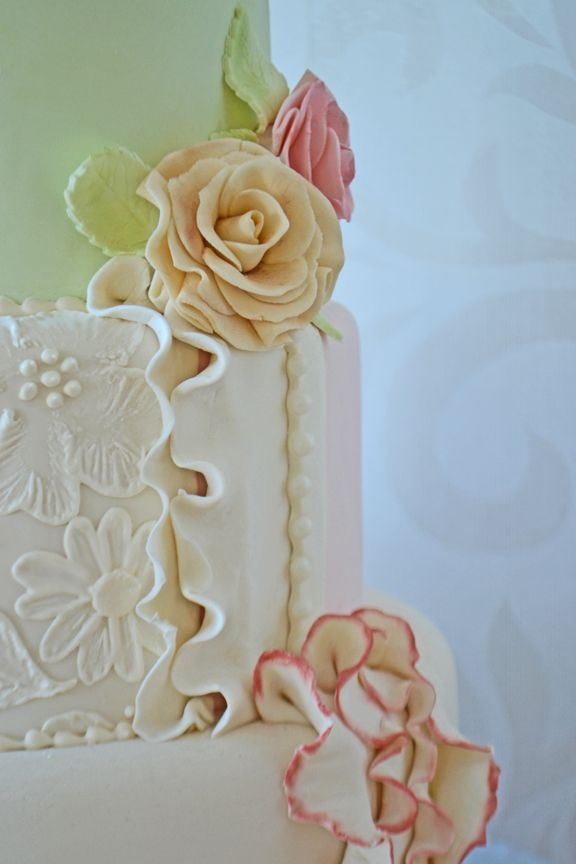 Vintage themed wedding cake with ivory lace and ruffles. Cake by Bake Sale Toronto.