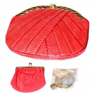 With matching red coin purse and gold mirror and comb, still in the unopened, original packaging.   Condition: appears to be excellent