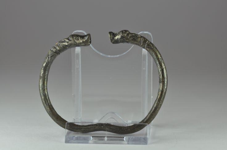 Achaemenid silver bracelet, 550-330 B.C. Achaemenid Iran silver bracelet with facing calfs heads, 8 cm diameter. Private collection