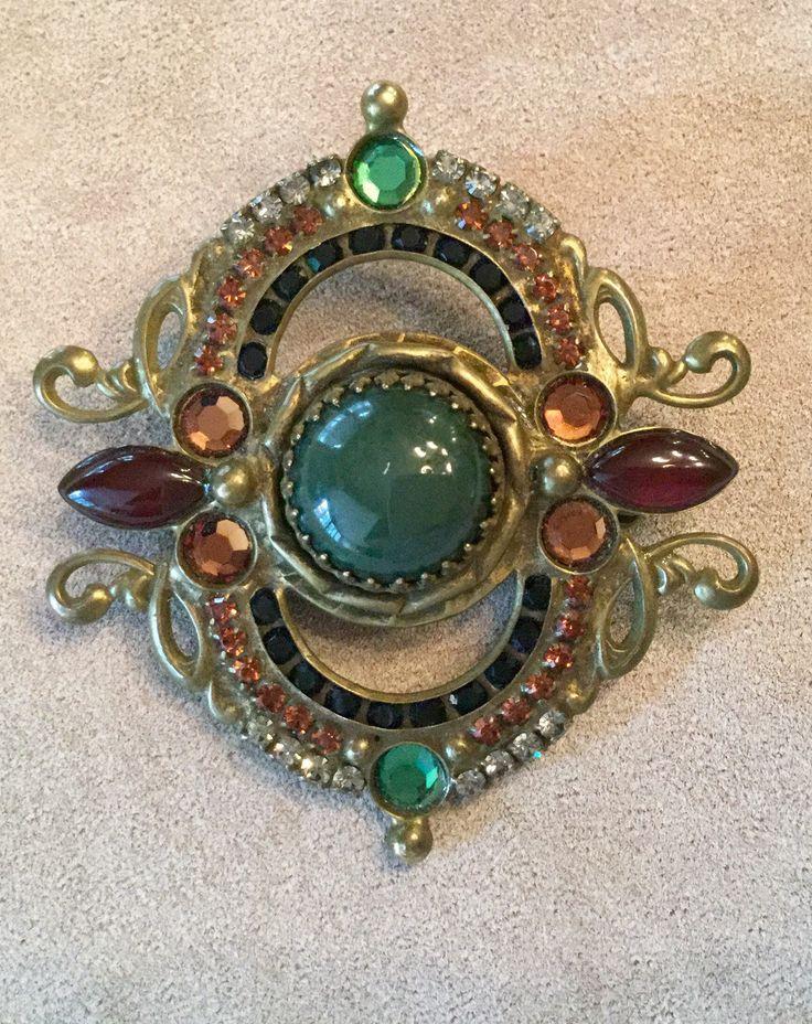A personal favorite from my Etsy shop https://www.etsy.com/listing/513990842/vintage-sorrelli-gemstone-brooch