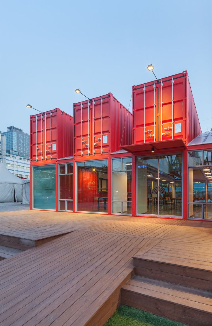 Bold, #red-colored #shipping #containers were used to create a (12 meter long) visitor area extension for the National Theatres Company of Korea. Designed as a social zone for theatregoers, the space was equipped with internal sliding partition walls that can be opened or closed to allow for flexible use of the #interior spaces.