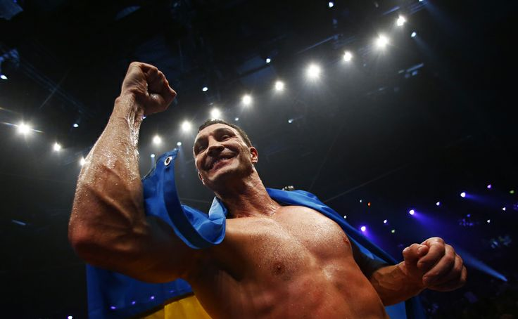 World heavyweight boxing champion Vladimir Klitschko of Ukraine celebrates after defeating Australian challenger Alex Leapai during their WBO heavyweight title fight in Oberhausen April 26, 2014. Klitschko won after knock out in round six. REUTERS/Kai Pfaffenbach