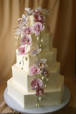 Hexagon 5 tiered white cake with orchids by Ellen Bartlett from Cakes to Remember.