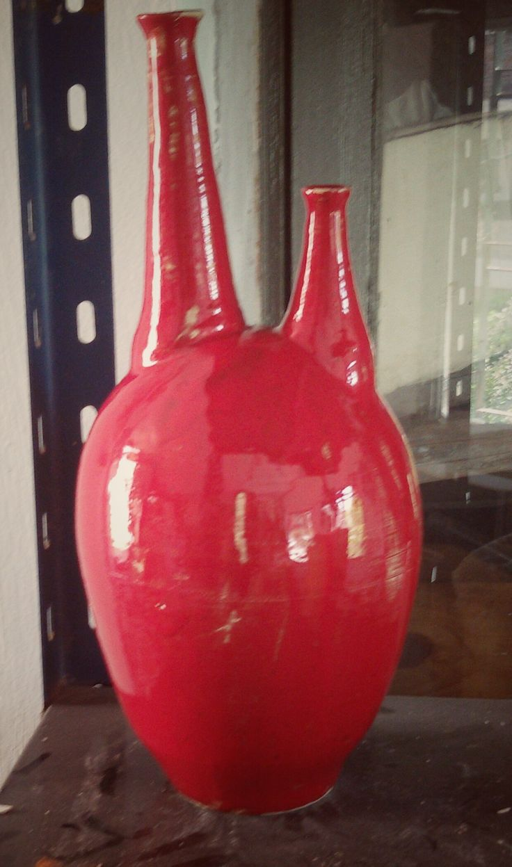 Decorado con esmalte rojo de selenio. 1010°/1020°C.