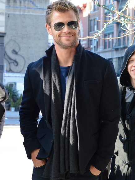 Swoon! Sexiest Man Alive Chris Hemsworth shows off his new haircut while in chilly New York City on Tuesday. Oh that smile...