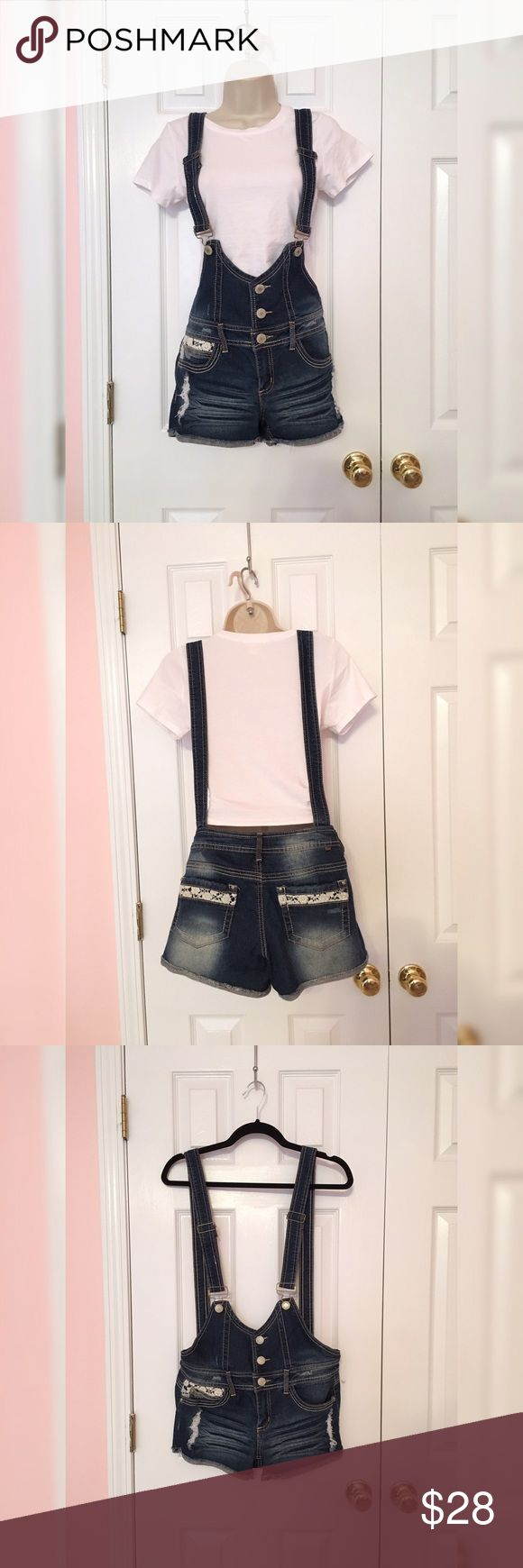 """Jean Overall Shorts Overall shorts with pretty lace detail on 3 of the 4 pockets. Dark wash jean material. 76% cotton, 22% polyester, 2% spandex. Worn a few times, in good condition. Purchased from Kohl's. I'm 5'7"""" & they're too short on me. *Crop top not for sale.* Almost Famous Jeans Overalls"""