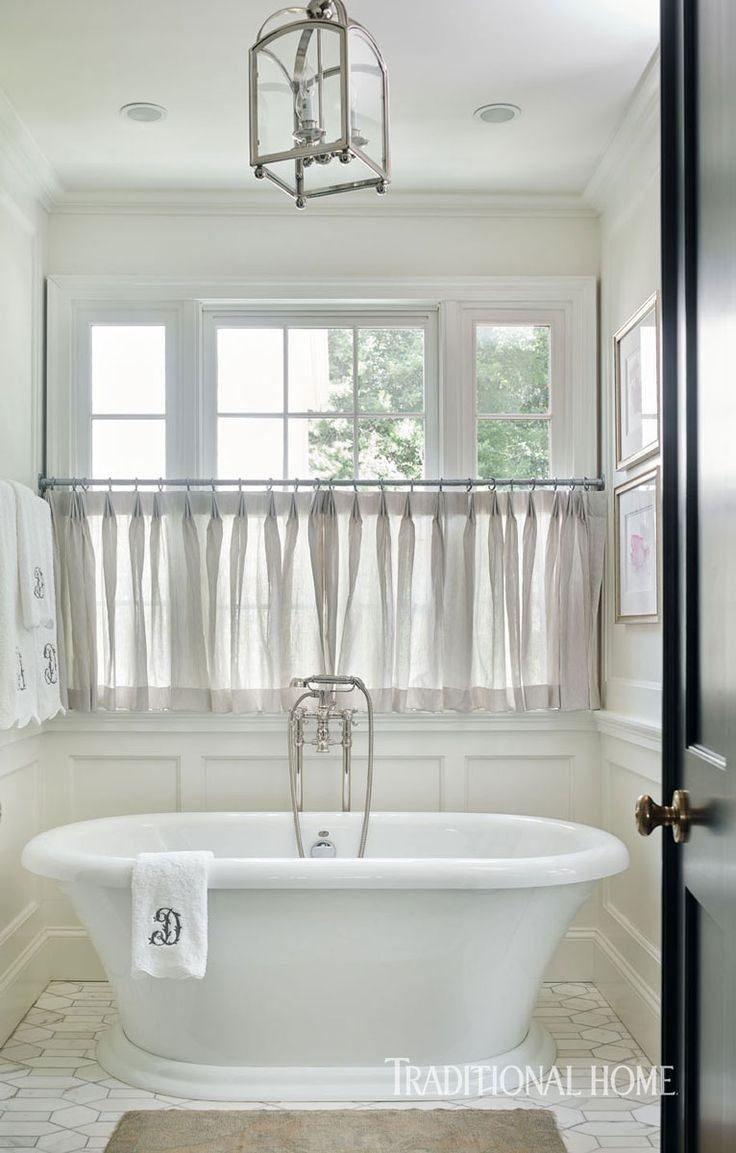 Cafe curtains for bathroom - A Light Filled Niche Holds A Freestanding Soaking Tub Sheer Caf Curtains Provide Privacy Without Blocking Sunlight
