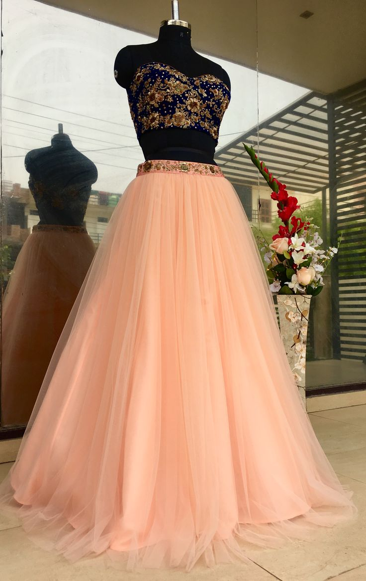 Heavily embroidered bustier crop top and tulle skirt is so charming and pretty! :)