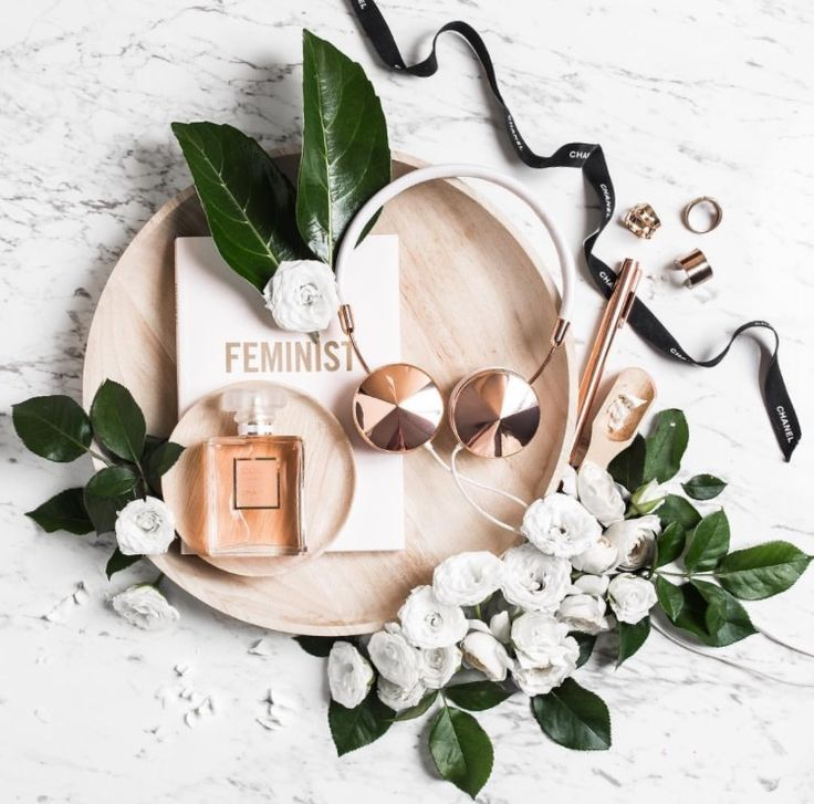Flatlay With Green Palm Tree Leaves, White Flowers And Rose Gold Accessories